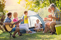Family playing a guitar and singing Royalty Free Stock Photo