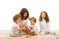 Family playing home of four members with wooden toy on carpet Royalty Free Stock Photo