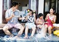 Family playing musical instruments by the pool Royalty Free Stock Photo