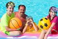 Family playing in pool Royalty Free Stock Photos
