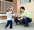 Family playing with soccer ball Royalty Free Stock Image