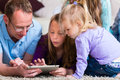Family playing with Tablet computer at home Royalty Free Stock Photo