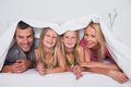 Family playing under the quilt Royalty Free Stock Photo