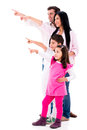 Family pointing away happy isolated over a white background Royalty Free Stock Photos