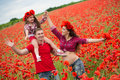 Family On The Poppy Field