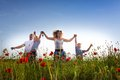 Family on the poppy meadow Royalty Free Stock Photo