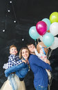 Family portrait with balloons in the studio Royalty Free Stock Photo