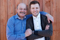 Family portrait. Father-in-law embraces the son-in-law Royalty Free Stock Photo