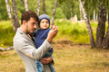 Family portrait. Father play with his child. Father holding a child in his arms. They are happy. Happy family walking outdoor Royalty Free Stock Photo