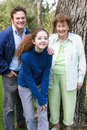 Family portrait with grandma father and teenage daughter pose for an outdoor a lovely senior grandmother Royalty Free Stock Photo
