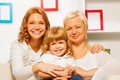 Family portrait with gril mother and granny happy of happy little granddaughter seating together hugging Stock Images