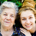 Family portrait - happy senior woman and daughter Stock Photography