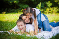 Family portrait in a park lie at meadow fun Stock Photos