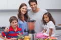 Family posing with a blender in the kitchen Stock Photography