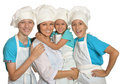 Family posing in chef uniforms Royalty Free Stock Photo