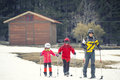 Family practicing cross-country skiing. The volcano Mount Etna, Sicily. Italy.
