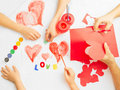 Family prepare for valentine s day paintings and origami of heart concept of Stock Photography