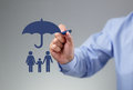 Family protection businessman hand drawing an umbrella above a concept for security finance and insurance Royalty Free Stock Images