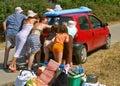 image photo : Family pushes the car