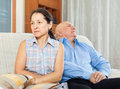 Family quarrel. Mature woman having conflict with  senior man Royalty Free Stock Photo