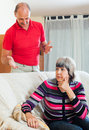 Family quarrel mature woman having problems with husband women at home Royalty Free Stock Photo