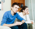Family quarrel sad guy and women during in living room at home Royalty Free Stock Photo