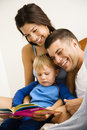 Family reading book. Royalty Free Stock Photo