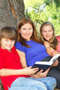 Family reading a book Royalty Free Stock Photography