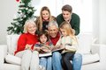 Family reading book together in house happy multigeneration Stock Photo