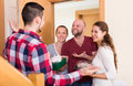 Family receiving visitors couple with the gifts at the home Royalty Free Stock Images