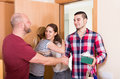Family receiving visitors happy couple with the gifts at the home Royalty Free Stock Images