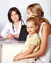 Family on reception at doctor. Stock Images