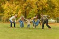 Family relaxing in autumn forest Royalty Free Stock Photo