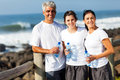 Family relaxing beach portrait of after exercise at the Royalty Free Stock Photo