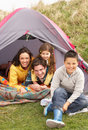 Family Relaxing Inside Tent On Camping Holiday Stock Image