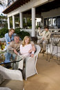 Family relaxing on outdoor patio Royalty Free Stock Images