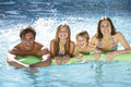 Family Relaxing In Swimming Pool Together Royalty Free Stock Photo