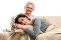 Family rest senior mother adult woman indoor isolated women resting on pillow smiling tenderness on white Stock Images