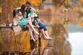 Family resting on the lake Royalty Free Stock Photo