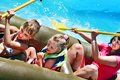 Family ride rubber boat with children at swimming pool Stock Photos