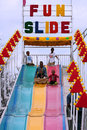 Family Rides Fun Slide At Atlanta Fair Royalty Free Stock Photo