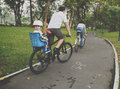 Family riding bicycle in the park on holiday Concept Royalty Free Stock Photo
