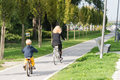 Family riding bicycles mother and son bike in park Royalty Free Stock Photography