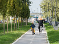 Family riding bicycles mother and son bike in park Royalty Free Stock Photo