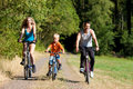 Family riding bicycles for sport Stock Photography