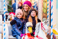 Family riding the carousel on Christmas market Royalty Free Stock Photo