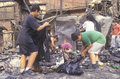 Family rummaging through home burned during riots Royalty Free Stock Photos