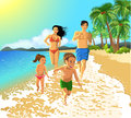 Family running on the beach happy in a summer vacation Stock Photo