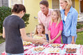 Family Running Charity Bake Sale Royalty Free Stock Photos