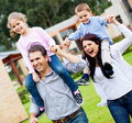 Family running outdoors Royalty Free Stock Images